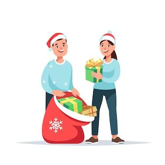 Gente feliz dando donar regalo navideño pareja voluntaria con gran bolsa de regalo de navidad