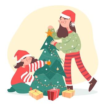 Gente feliz que adorna el árbol de navidad
