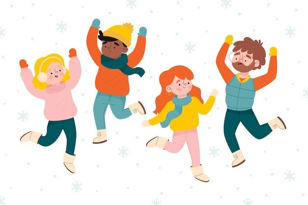 La gente feliz salta el fondo de la temporada de invierno