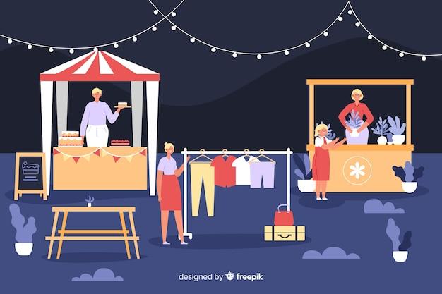 Gente en una feria de noche de diseño plano.