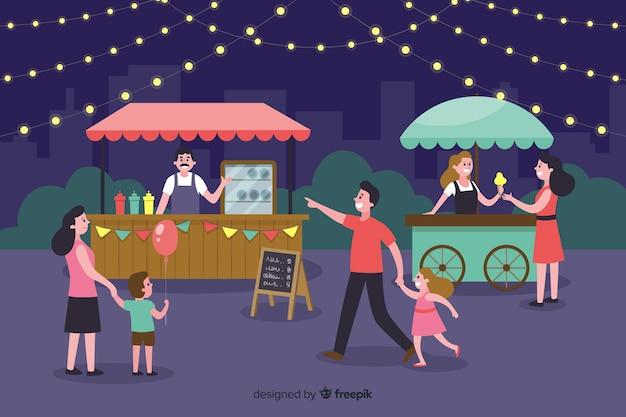 Gente en una feria nocturna
