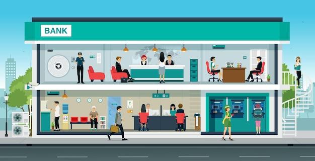 La gente hace negocios financieros en bancos con cajeros automáticos.