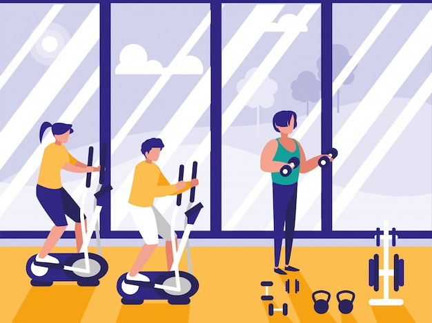 Gente haciendo spinning en gimnasio