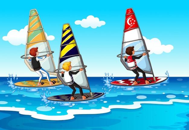 Gente haciendo windsurf en el mar.
