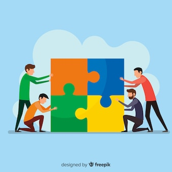 Gente juntado piezas de puzzle