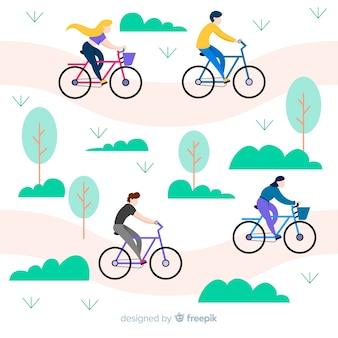 Gente montando en bicicletas en el parque