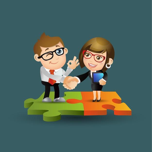 Gente de negocios de pie sobre las piezas de un rompecabezas.