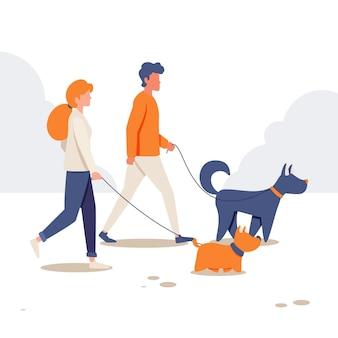 Gente paseando al perro en la naturaleza