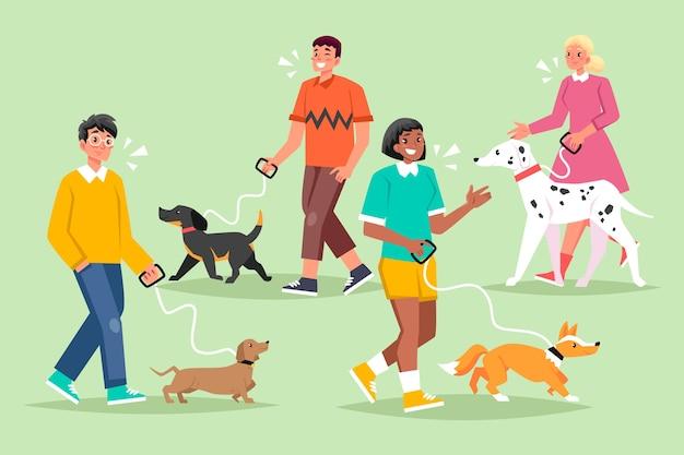 Gente paseando por la colección de perros
