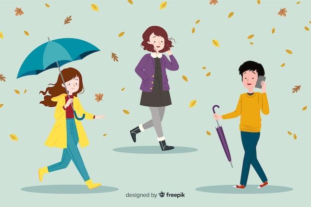 Gente paseando en otoño en diseño plano