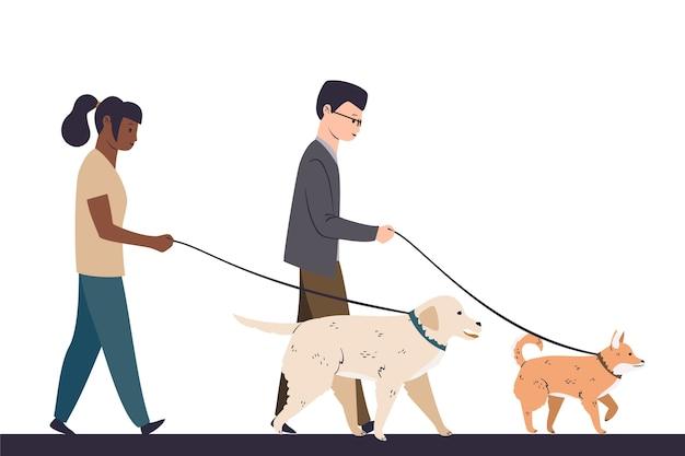 Gente paseando a su perro juntos