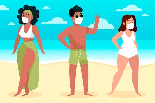 Gente en la playa con mascarillas