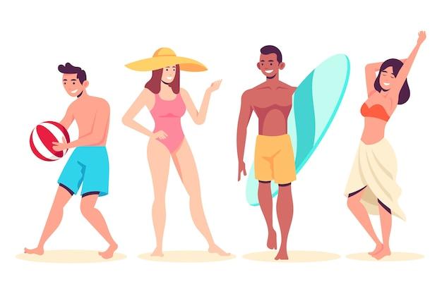 Gente en la playa de pie