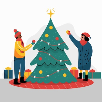 Gente preparando el árbol de navidad