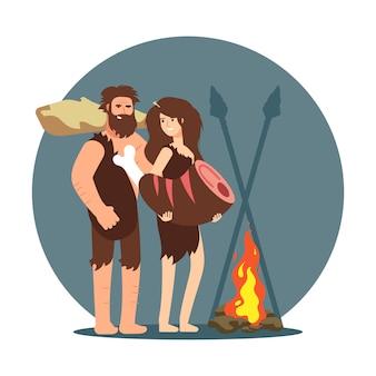 Gente primitiva que cocina la cena a fuego abierto