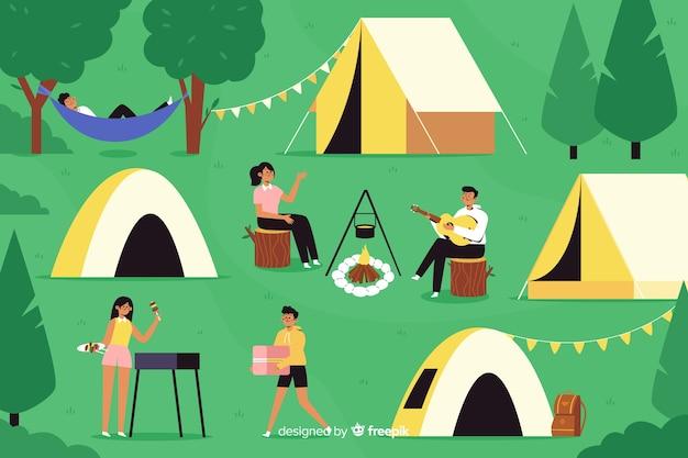 Gente que acampa teniendo un maravilloso fin de semana