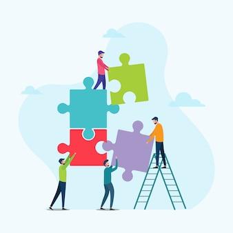 Gente que conecta los elementos del rompecabezas símbolo de trabajo en equipo