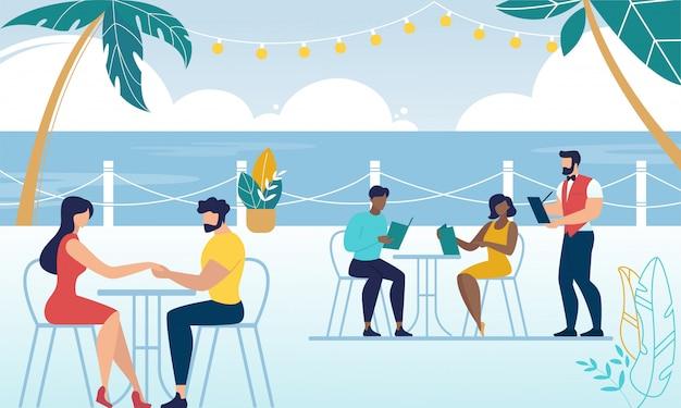 La gente se relaja en la cafetería o cafetería.