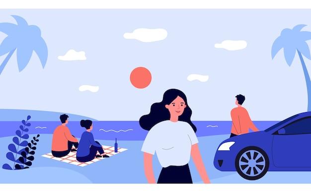 Gente relajándose en la playa del mar