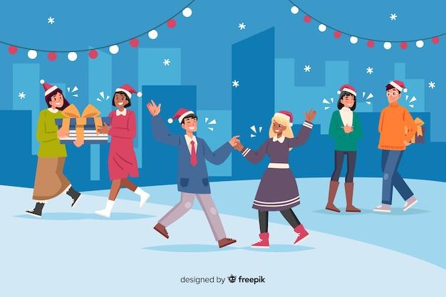 Gente reunida afuera para celebrar dibujos animados de navidad