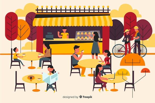Gente sentada en la cafetería otoño