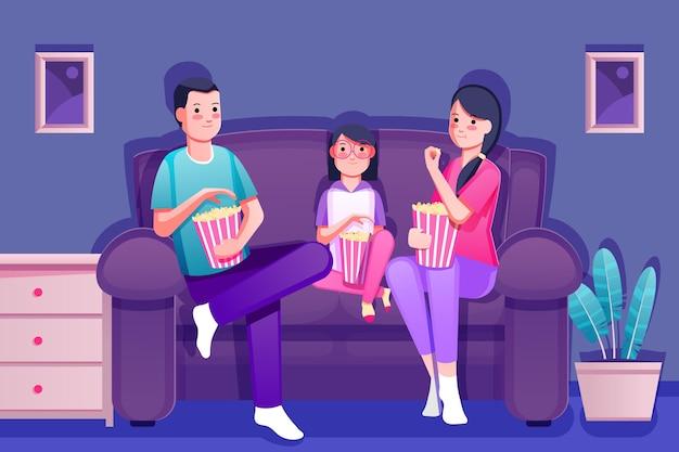 Gente viendo una película en casa