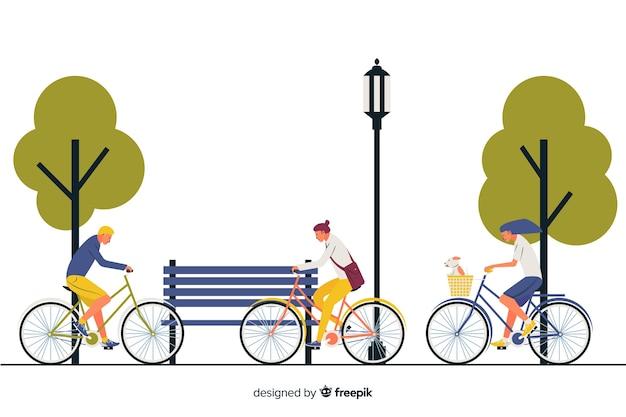 Gente yendo en bici por el parque