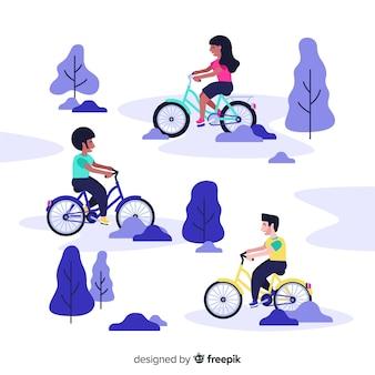 Gente yendo en bici en el parque