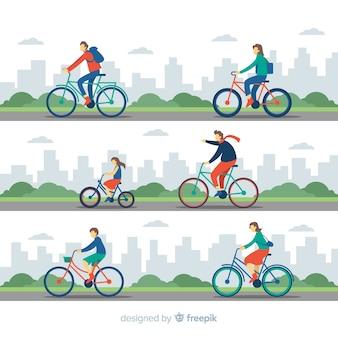 Gente yendo en bicicleta por el parque