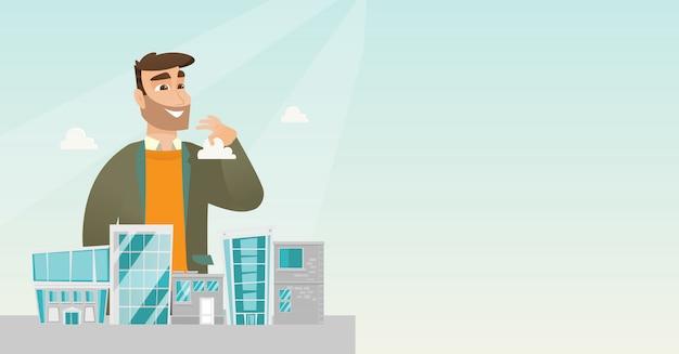Gerente de ventas presentando modelo de ciudad.