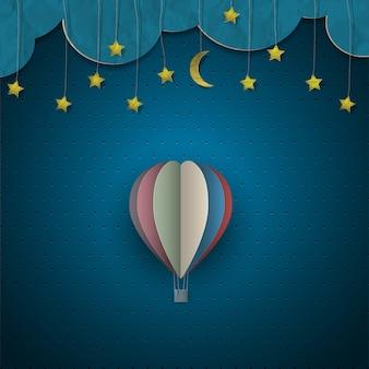 Globo aerostático y luna con estrellas.