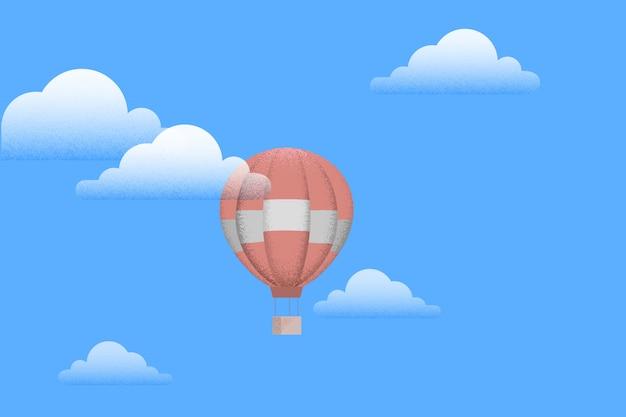Globo aerostático con nubes blancas sobre cielo azul