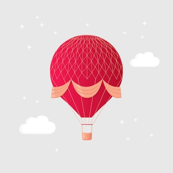 Globo de aire caliente retro vintage con canasta en el cielo