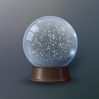 Globo de nieve o bola de navidad con un remolino de copos de nieve