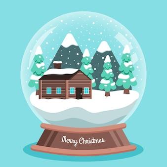 Globo plano de bola de nieve navideña con casa