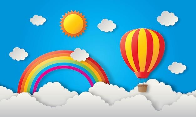Globo de viaje de arte de papel volando con sol, arco iris y nubes.