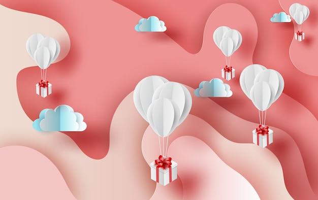 Globos de aire blanco de regalo flotando en rosa.