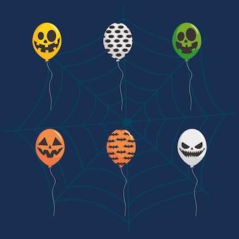 Globos de colores con icono de diseño de halloween sobre fondo azul y araña