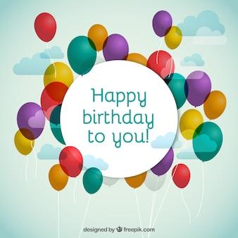 Globos del cumpleaños con el saludo feliz cumpleaños
