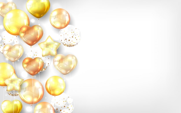 Globos de oro sobre fondo blanco.