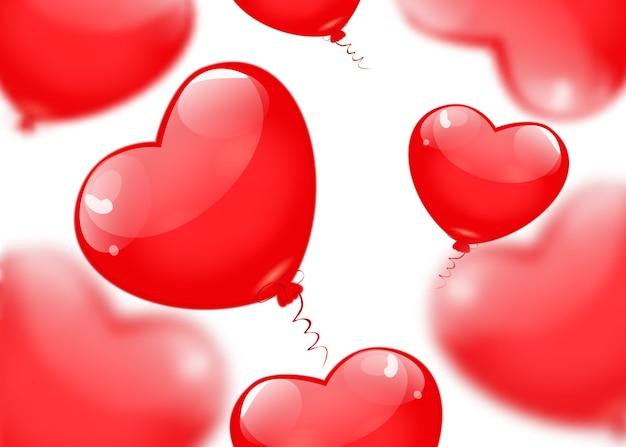 Globos rojos en forma de corazón aislado sobre fondo blanco.