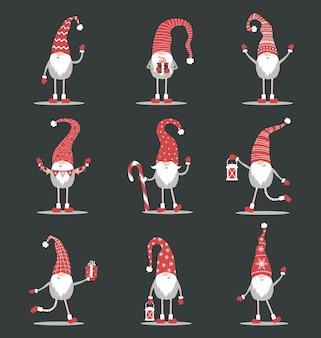 Gnomos lindos con sombreros rojos de santa sobre fondo negro. elfos navideños escandinavos.
