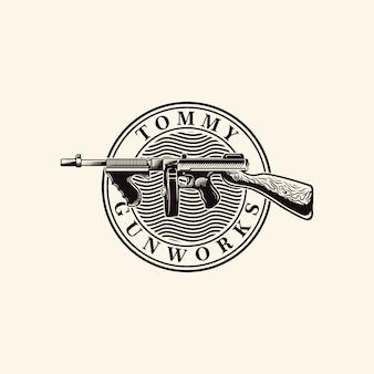 Grabado del logotipo de tommy gun vector