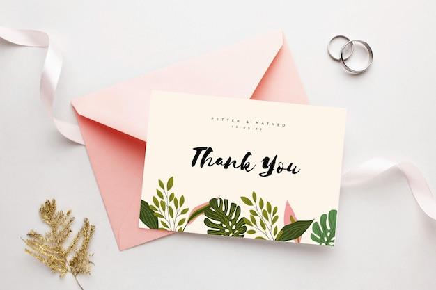 Gracias por venir tarjeta de boda y anillos.