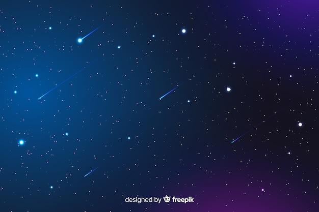 Gradiente de fondo nocturno con estrellas fugaces