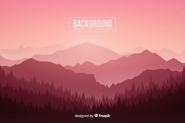 Gradiente de luz rosa en las montañas con árboles