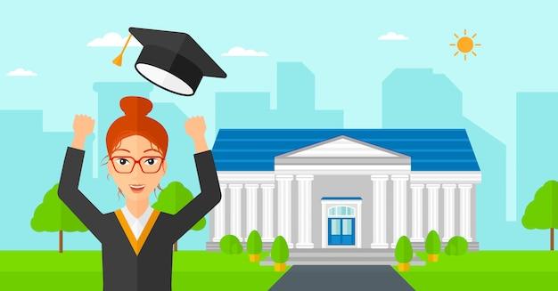 Graduado levantando su sombrero