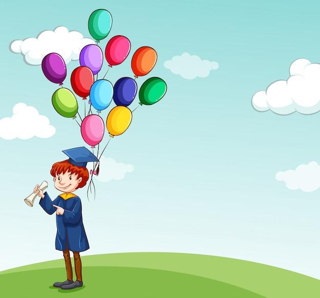 Graduado, niño sosteniendo globos