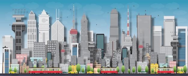 Gran ciudad con rascacielos y casas pequeñas.