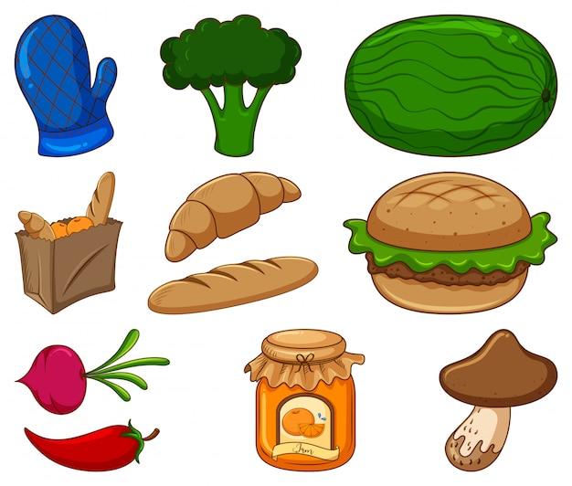 Gran conjunto de diferentes alimentos y otros artículos sobre fondo blanco.